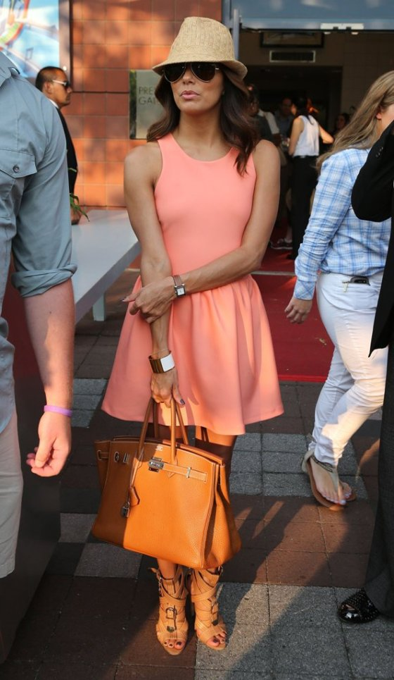 Eva Longoria with her orange birkin and in a coral spring dress